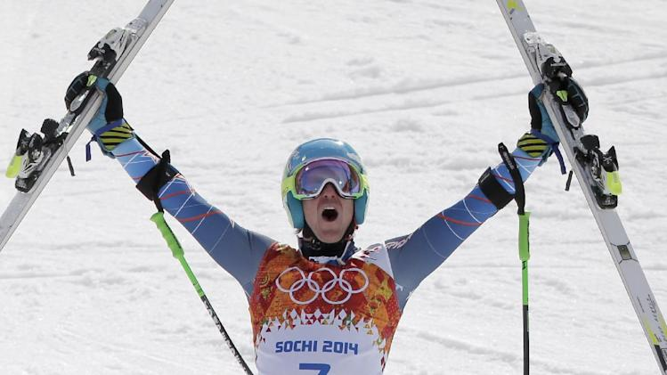 United States' Ted Ligety celebrates after winning the gold medal in the men's giant slalom at the Sochi 2014 Winter Olympics, Wednesday, Feb. 19, 2014, in Krasnaya Polyana, Russia