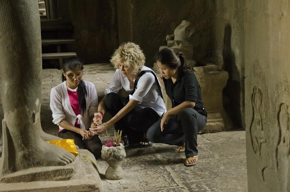 "This undated image provided by PBS shows actress Meg Ryan in Cambodia. Ryan, America Ferrara and Olivia Wilde are among the actresses who brought their star power to the PBS documentary ""Half the Sky,"" which details efforts to help exploited women worldwide. It airs Monday and Tuesday, Oct. 1-2. (AP Photo/PBS, David Smoler)"