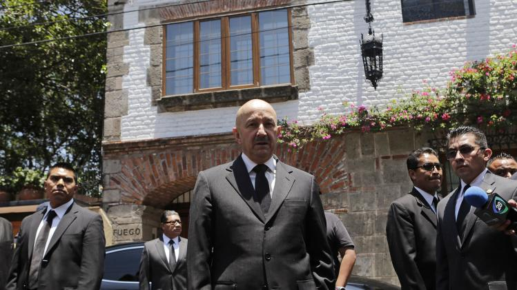 Former Mexican President Carlos Salinas de Gortari speaks with journalists after visiting the home of Colombian Nobel Prize laureate Gabriel Garcia Marquez in Mexico City