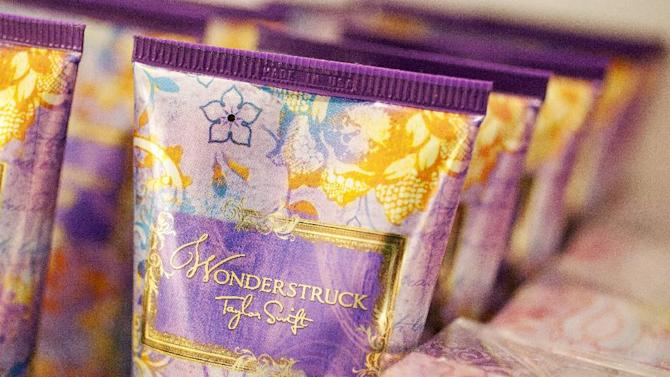 In this Aug. 23, 2012, photo, Wonderstruck body lotion from the Taylor Swift collection is displayed at a Lord & Taylor department store in New York. Celebrities have long dabbled in design, but with the growth of TV shows and websites that follow everything celebrities say, wear and do, interest in their clothing lines has risen in recent years. North America revenue from celebrity clothing lines, excluding merchandise linked to athletes, rose 6 percent last year to an historic peak of $7.58 billion in 2011, according to the latest figures available by The Licensing Letter, an industry trade. That's on top of a nearly 5 percent increase in 2010.  (AP Photo/Mark Lennihan)