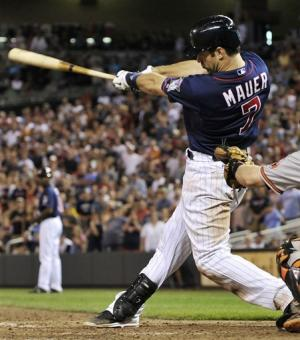Mauer, bullpen lift Twins over Orioles 6-4