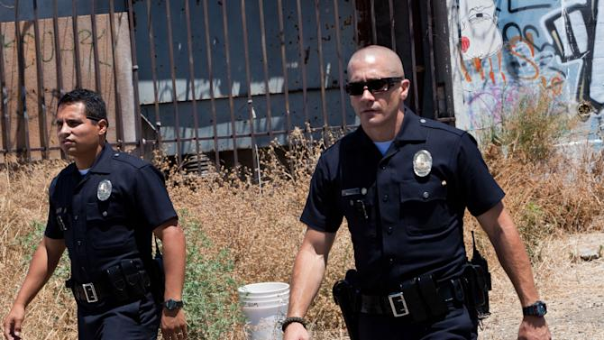 """This film image released by Open Road Films shows Michael Pena, left, and Jake Gyllenhaal in a scene from """"End of Watch."""" (AP Photo/Open Road Films, Scott Garfield)"""