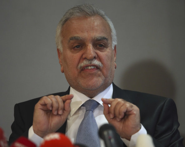 "Iraq's Vice President Tariq al-Hashemi speaks to the media during a news conference in Ankara, Turkey, Monday, Sept. 10, 2012. Iraq's fugitive Sunni vice president on Monday declared his ""absolute innocence"" and rejected the terror trial that sentenced him to death on charges of masterminding the murder of rivals as a politically motivated sham. (AP Photo/Burhan Ozbilici)"