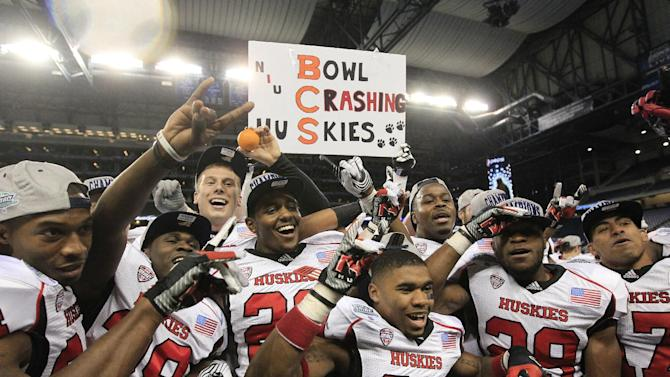 The Northern Illinois team poses for photographers after defeating Kent State 44-37 in double overtime in the the Mid-American Conference championship in an NCAA college football game at Ford Field, Friday, Nov. 30, 2012, in Detroit. (AP Photo/Carlos Osorio)