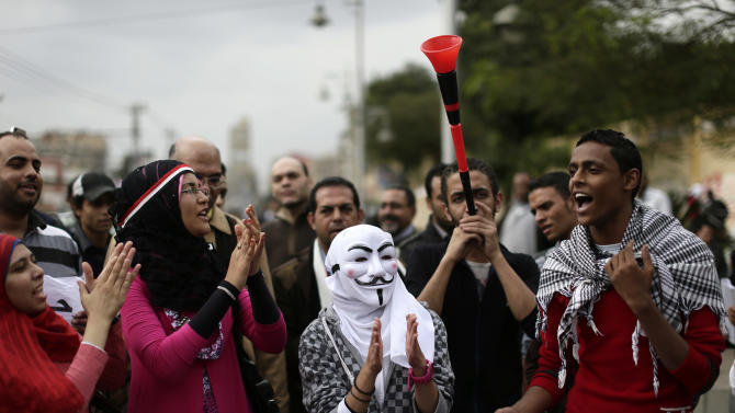 Egyptian protesters chant anti Muslim Brotherhood slogans outside the presidential palace, in Cairo, Egypt, Wednesday, Dec. 5, 2012. Supporters of President Mohammed Morsi and opponents clashed outside the presidential palace. Wednesday's clashes began when thousands of Islamist supporters of Morsi descended on the area around the palace where some 300 of his opponents were staging a sit-in. (AP Photo/Hassan Ammar)