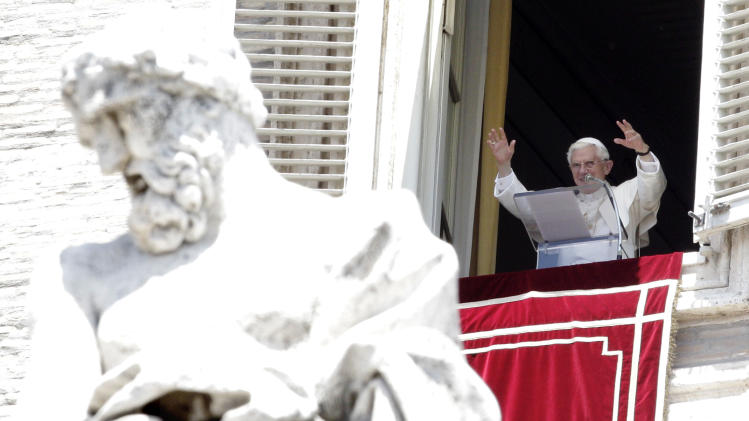 Pope Benedict XVI delivers his blessing during the Angelus prayer from his studio overlooking St. Peter's square at the Vatican, Sunday, June 17, 2012. (AP Photo/Riccardo De Luca)