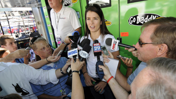 NASCAR Sprint Cup Series auto racing driver Danica Patrick talks to the media outside her hauler, Friday, May 31, 2013, at Dover International Speedway in Dover, Del. (AP Photo/Nick Wass)