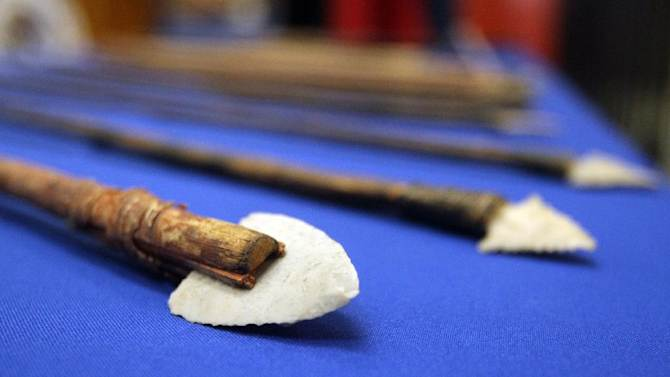 Some seized artifacts returned to Mexico are displayed on a table during a news conference at the Mexican Consulate in El Paso, Texas, Thursday, Oct. 25, 2012. More than 4,000 archaeological artifacts looted from Mexico and seized in the U.S. were returned to Mexican authorities on Thursday in what experts say is one of the largest repatriation ever made between the neighboring countries. (AP Photo/The El Paso Times, Mark Lambie)