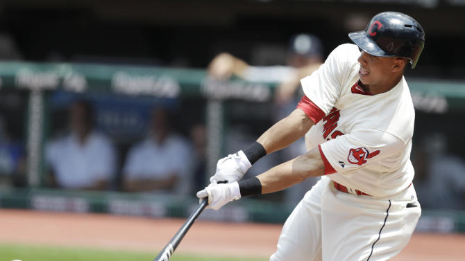 Cleveland Indians' Michael Brantley hits an RBI-single off Seattle Mariners starting pitcher Felix Hernandez in the first inning of the MLB American League baseball game Sunday May 19, 2013, in Cleveland. Michael Bourn scored on the hit. (AP Photo/Tony Dejak)