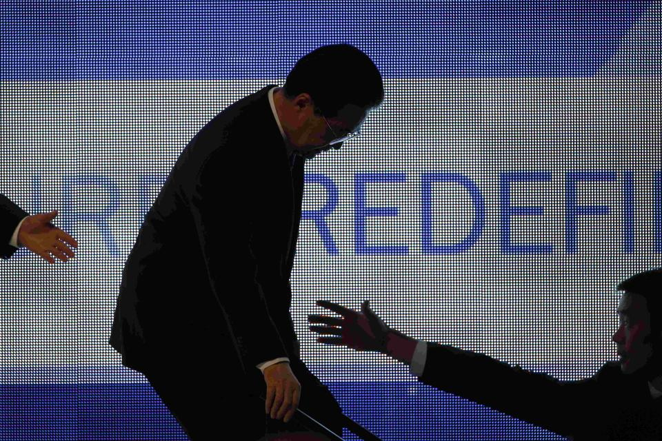 Chinese President Hu Jintao is assisted off the stage after addressing the APEC CEO Summit, a gathering of business leaders at the Asia-Pacific Economic Cooperation summit Saturday, Nov. 12, 2011, in Honolulu. (AP Photo/Andres Leighton)