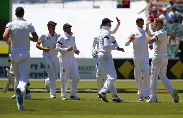 England's Stokes celebrates with teammates after taking the wicket of Australia's Siddle during second day's play in second Ashes cricket test at Adelaide Oval
