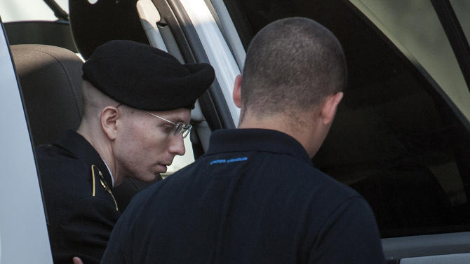 Army Pfc. Bradley Manning is helped out of a security vehicle as he arrives at a courthouse at Fort Meade, Md., Friday, July 26, 2013. Manning is charged with indirectly aiding the enemy by sending troves of classified material to WikiLeaks. He faces up to life in prison. (AP Photo/Cliff Owen)