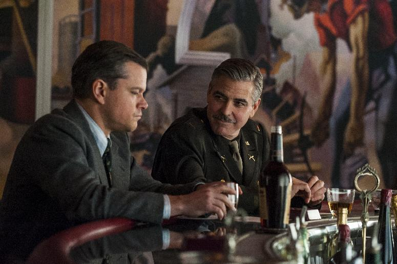 "This film image released by Columbia Pictures shows Matt Damon, left, and George Clooney in ""The Monuments Men."" (AP Photo/Columbia Pictures - Sony, Claudette Barius)"