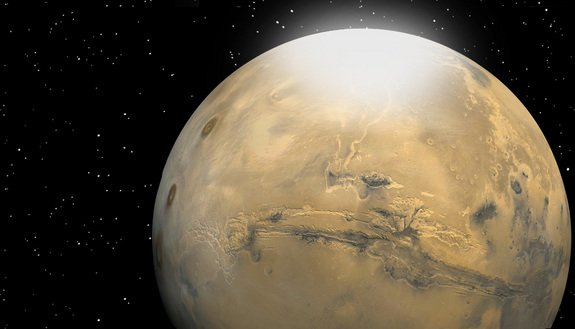 Researchers have calculated that carbon dioxide snow particles on Mars are roughly the size of a human red blood cell. Martian snow is depicted in this artist's rendering as a mist or fog that eventually settles to the surface.