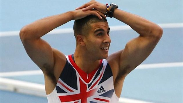 Adam Gemili of Britain reacts after seeing his time of 19.98s to win his 200m semi-final at the World Championships (REUTERS)