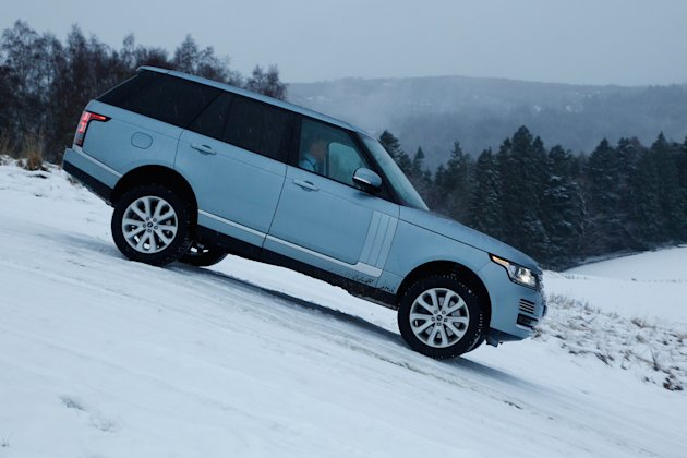 Range Rover: 	Its the new Range Rovers job to look good everywhere, from deserts to driveways, and though the press drives off-road were the tamest Ive ever seen, and the car slid about on its fat 