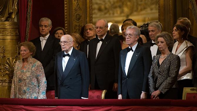 In this picture made available by the Italian Presidency, Italian President Giorgio Napolitano, second left, flanked by his wife Clio, Premier Mario Monti and his wife Elsa at the Milan La Scala theater, Italy, Wednesday, Dec. 7, 2011. Mozart's Don Giovanni, led by director Daniel Baremboim, will inaugurate the Milan's opera house season Wednesday. (AP Photo/Paolo Giandotti, Italian Presidency Handout)