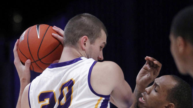 Northern forward Jake Koch (20) is covered by Memphis forward Ferrakohn Hall (0) during the first half of an NCAA college basketball game at the Battle 4 Atlantis tournament, Saturday, Nov. 24, 2012 in Paradise Island, Bahamas. (AP Photo/John Bazemore)