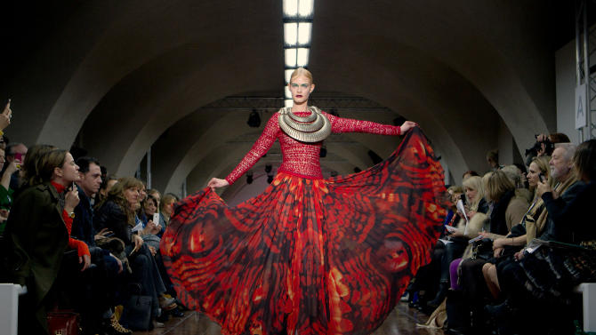 A model displays a creation by designer Fyodor Golan during a fashion show at London Fashion Week, Friday, Feb. 17, 2012. (AP Photo/Joel Ryan)