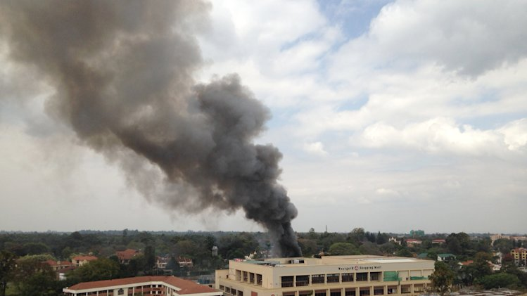 Heavy smoke rises from the Westgate Mall in Nairobi Kenya Monday Sept. 23 2013. Multiple large blasts have rocked the mall where a hostage siege is in its third day. Associated Press reporters on the scene heard multiple blasts and a barrage of gunfire. Security forces have been attempting to rescue an unknown number of hostages inside the mall held by al-Qaida-linked terrorists. (AP Photo/ Jerome Delay)