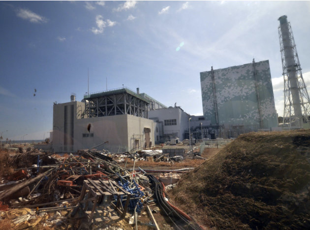 Debris is seen scattered near the Unit 6 reactor building of stricken Fukushima Dai-ichi nuclear power plant of Tokyo Electric Power Co., in Okuma town, Fukushima prefecture, northeastern Japan Tuesda