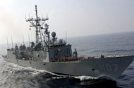 File picture shows a frigate during a drill off southern Taiwan in 2007. Taiwan said Monday that three retired military officers have been arrested on suspicion of leaking military secrets to China, in what legislators described as one of the island&#39;s worst espionage cases. They include Chang Chih-hsin, formerly in charge of political warfare at the navy&#39;s meteorology and oceanography office
