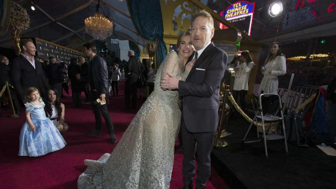 "Director Kenneth Branagh and cast member Lily James pose at the premiere of ""Cinderella"" at El Capitan theatre in Hollywood"