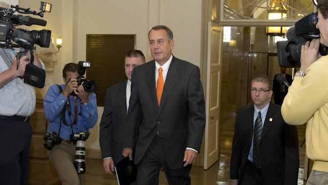 House Speaker John Boehner of Ohio arrives on Capitol Hill, Wednesday, Oct. 16, 2013, in Washington. Chaos among Republicans in the House of Representatives has left it to bipartisan leaders in the Senate to craft a last-minute deal to fend off a looming U.S. default and to reopen the federal government as a partial shutdown entered its 16th day. (AP Photo/Carolyn Kaster)