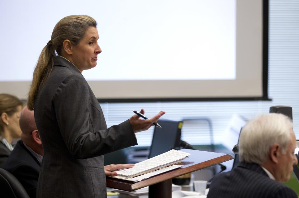 Heather Peters speaks in court Friday, March 16, 2012, in San Diego.  A judge tentatively approved a settlement to give owners of Honda Civic hybrids up to $200 cash over claims that the cars' fuel economy was inflated. (AP Photo/Gregory Bull)