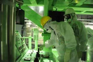 Handout photo shows Barrett, a member of TEPCO outside…