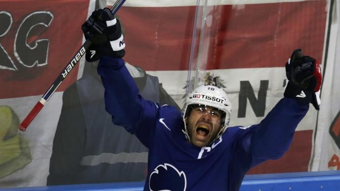 France's Meunier celebrates after scoring against Austria during their Ice Hockey World Championship game at the O2 arena in Prague
