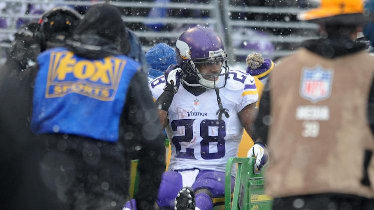 Minnesota Vikings running back Adrian Peterson is carted off the field after injuring his ankle on a play in the second quarter of an NFL football game against the Baltimore Ravens, Sunday, Dec. 8, 2013, in Baltimore