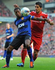 Liverpool&#39;s Luis Suarez (R) and Manchester United&#39;s Patrice Evra during an English Premier League match in October 2011. Suarez was banned for eight matches for using the Spanish word &#39;negrito&#39; (little black) in a clash with Evra last season
