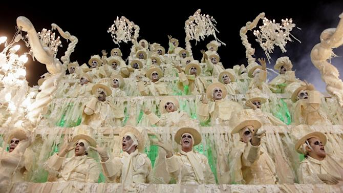 Performers from the Unidos da Tijuca samba school parade during carnival celebrations at the Sambadrome in Rio de Janeiro, Brazil, early Monday, Feb. 11, 2013. (AP Photo/Hassan Ammar)