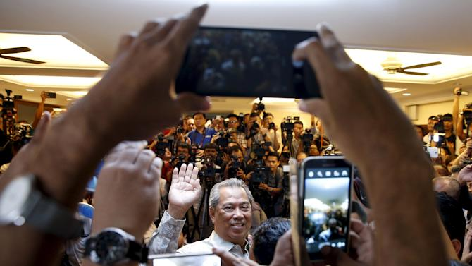 Former Malaysian Deputy Prime Minister Muhyuddin Yassin speaks to the media after he was sacked during yesterday's cabinet reshuffle in Kuala Lumpur, Malaysia