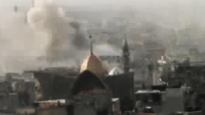 This image made from amateur video and released by Shaam News Network Monday, March 26, 2012, purports to show smoke rising from buildings in Homs, Syria. Syrian troops shelled rebel-held neighborhoods in the central city of Homs on Monday with at least five people seriously wounded. Homs has been one of the cities hardest hit by the government crackdown on the uprising that began last March. (AP Photo/Shaam News Network via APTN) THE ASSOCIATED PRESS CANNOT INDEPENDENTLY VERIFY THE CONTENT, DATE, LOCATION OR AUTHENTICITY OF THIS MATERIAL. TV OUT