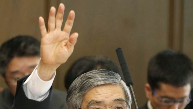 Bank of Japan Gov. Haruhiko Kuroda raises a hand to answer during a session by the upper house financial affairs committee of the Parliament in Tokyo Thursday, March 28, 2013. Japan's economy has stopped weakening and should show signs of recovery by midyear, the newly appointed central bank governor said Thursday, as weaker-than-expected retail sales for February underscored the challenge he faces in restoring consumer confidence. (AP Photo/Kyodo News) JAPAN OUT, MANDATORY CREDIT, NO LICENSING IN CHINA, HONG KONG, JAPAN, SOUTH KOREA AND FRANCE