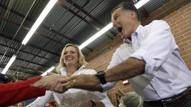 Republican presidential candidate, former Massachusetts Gov. Mitt Romney, and his wife Ann greet supporters at Absolute Style furniture Sunday, Aug. 12, 2012, in High Point, N.C.  (AP Photo/Mary Altaffer)