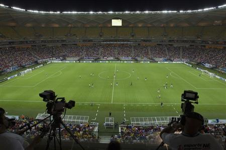 An overview of the Arena Amazonia Vivaldo Lima soccer stadium during the inaugural match in Manaus