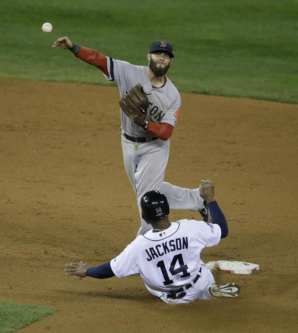 Boston Red Sox second baseman Dustin Pedroia throws to first after forcing Detroit Tigers' Austin Jackson out at second sixth inning during Game 4 of the American League baseball championship series Wednesday, Oct. 16, 2013, in Detroit. (AP Photo/Carlos Osorio)