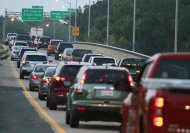 Cars clog the roadway to the Hampton Roads Bridge Tunnel as Hurricane Irene approaches, Thursday, Aug. 25, 2011, in Norfolk, Va. Forecasters at the National Hurricane Center Thursday afternoon also issued the first warnings for the entire North Carolina coast to the Virginia border. One is also out for the coast of South Carolina from Edisto Beach north. (AP Photo/Steve Helber)