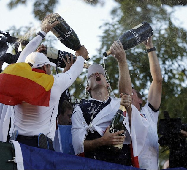 Players pour Champagne on Europe's Justin Rose as the celebrate after winning the Ryder Cup PGA golf tournament Sunday, Sept. 30, 2012, at the Medinah Country Club in Medinah, Ill. (AP Photo/Chris