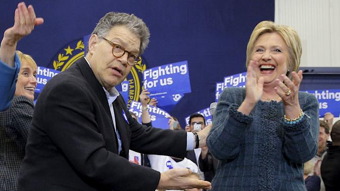 U.S. Democratic presidential candidate Hillary Clinton is joined onstage by U.S. Senator Al Franken at a campaign rally in Portsmouth