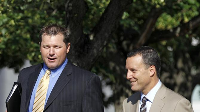 Former Major League Baseball pitcher Roger Clemens, left, arrives at federal court in Washington, Friday, June 8, 2012, for his perjury trial. (AP Photo/Haraz N. Ghanbari)