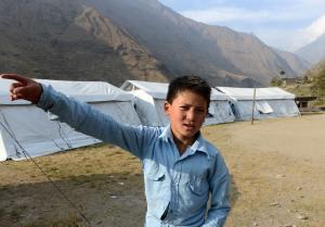 Nepalese schoolboy Dawa Phunchok Lama gestures as he…