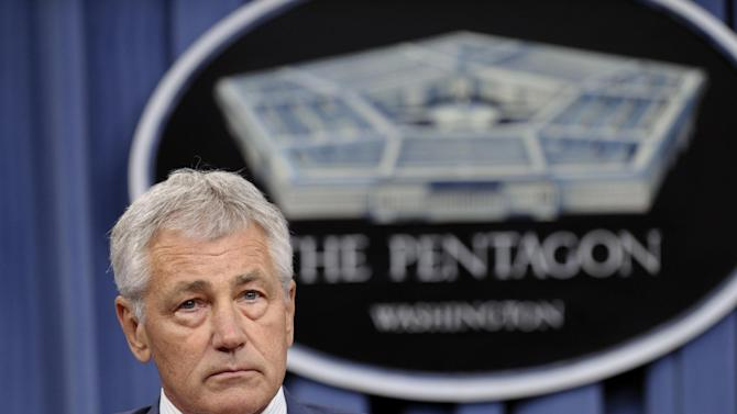 FILE - In this June 26, 2013 file photo Defense Secretary Chuck Hagel listens during a news conference at the Pentagon. Hagel is warning of severe and unacceptable effects on the U.S. military if Congress doesn't act to end automatic spending cuts slated to slice $52 billion from the defense budget for 2014. (AP Photo/Susan Walsh, File)