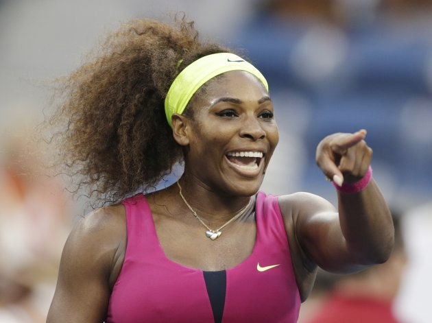 Serena Williams points to someone in the crowd after winning her match against Italy's Sara Errani during a semifinal match at the 2012 US Open tennis tournament, Friday, Sept. 7, 2012, in New York. (AP Photo/Charles Krupa)