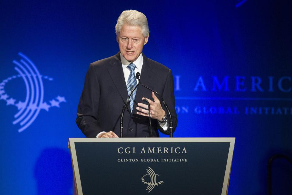 Former U.S. President Bill Clinton addresses the Clinton Global Initiative (CGI) meeting in Chicago, Thursday, June 13, 2013. During this opening session, Clinton was joined by other politicians and business leaders to discuss new ways to achieve economic and social mobility. (AP Photo/Scott Eisen)