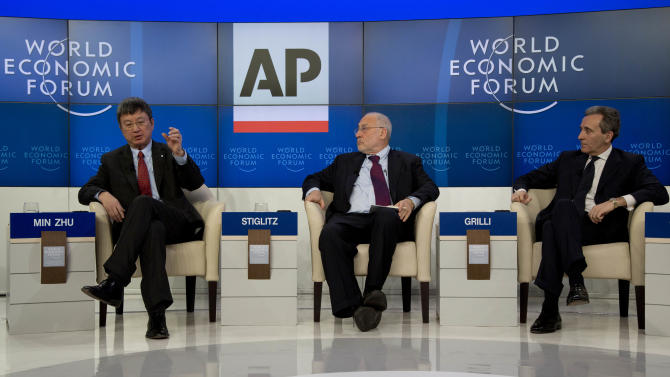 Chinese Min Zhu, Deputy Managing Director of the International Monetary Fund, U.S. professor Joseph E. Stiglitz and Vittorio Grilli, Italian Minister for Economy and Finance, from left to right, attend the Associated Press session 'Creating Economic Dynamism' during the 43rd Annual Meeting of the World Economic Forum, WEF, in Davos, Switzerland, Friday, Jan. 25, 2013.  (AP Photo/Anja Niedringhaus)