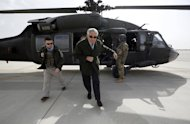 US Defense Secretary Chuck Hage steps off a military helicopter after arriving from Kabul, at Bagram airfield on March 9, 2013. A suicide bomber on a bicycle killed nine people outside the defence ministry in central Kabul on Saturday during a visit to the Afghan capital by new US Defense Secretary Chuck Hagel